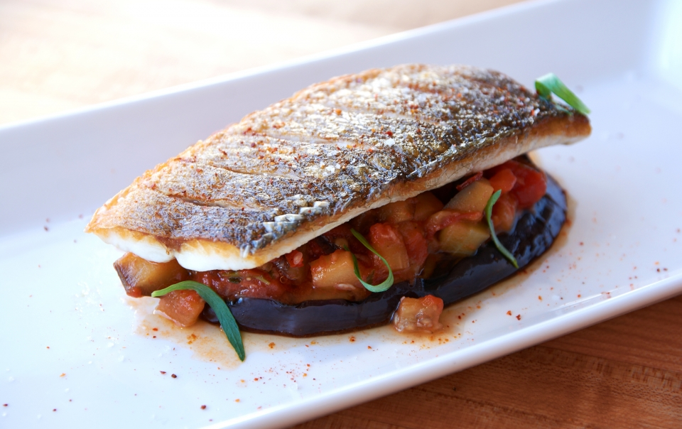 Pan-seared walleye on the skin and tomato and eggplant confit with tarragon