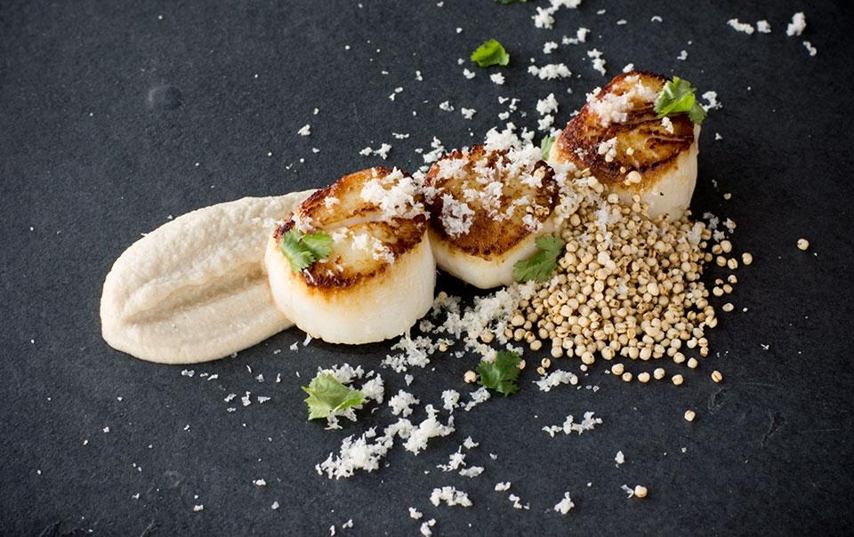 Pan-seared scallops, caramelized cauliflower puree, crispy quinoa, cilantro and cauliflower snow.